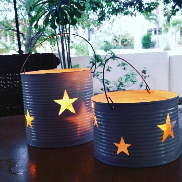 Candle holder lanterns made with Dremel from recycled tuna cans
